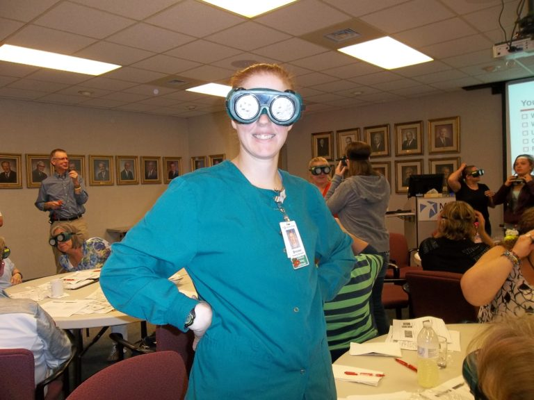 CNA with low-vision simulation goggles