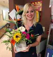 Kathryn Gerber holding flowers